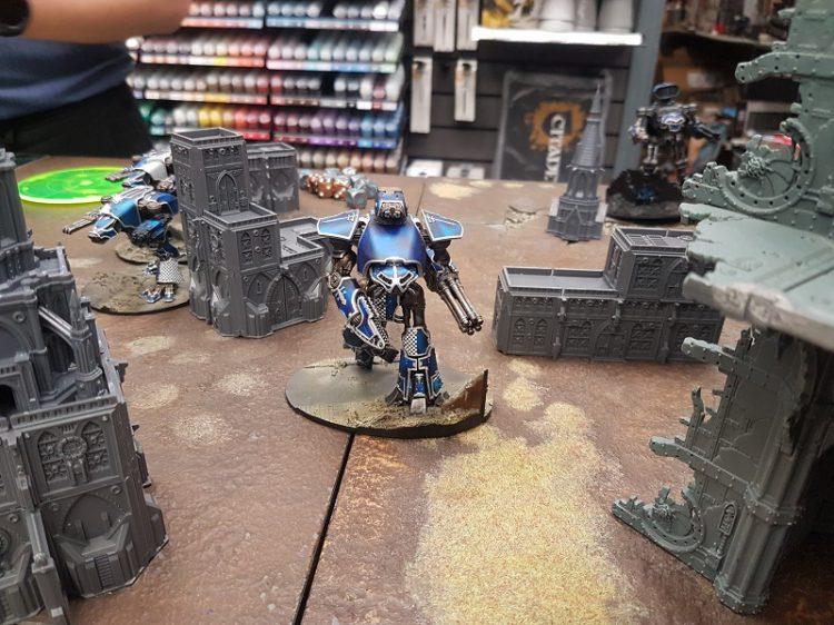 Legio Tempestus titans advancing on a battlefield